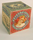 A square box seen from the side with a blond woman with poppies in her hair in a red circular form with the words 'Lefèvre-Utile Gaufrettes Vanille' on one side, and a picture of the LU factory in black and white on one of the other sides.