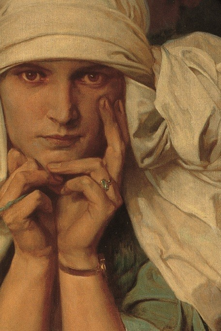 Close-up of a girl in a white headdress resting her head in her hands