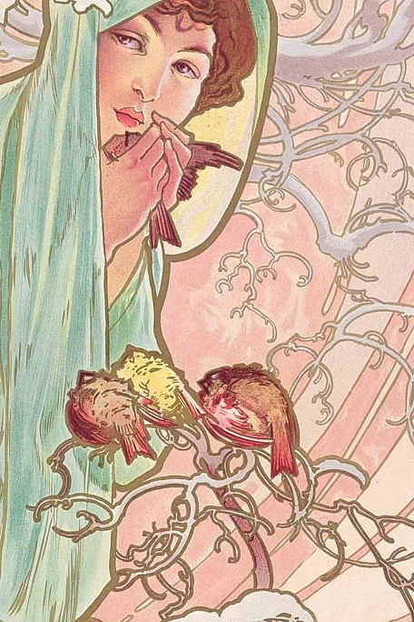 Close up of a dark haired woman wrapped in pale green drapery with a small bird in her hands