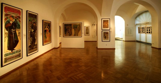 Interior view of the Mucha Museum with advertising posters