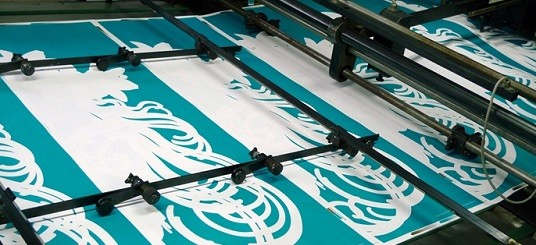"""Printing press printing exhibition poster for """"Mucha, Manga, Mystery"""" presented at the Bellerive Museum in Zurich in 2013"""