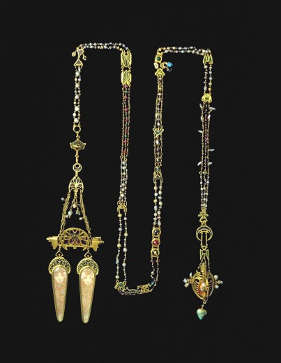 Ornate chain encrusted with pearls and semi-precious stones with a double pendant with two representations of female heads with swirling hair on elongated ivory panels