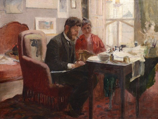 Bearded man with a pipe seated on a red armchair in front of a table with a woman in red to his left and a window to her left
