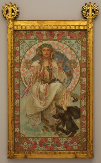 Female figure holding a circle in her left hand and coloured ribbons in her right hand with an ivy headdress sitting in a decorative halo with a bird of prey at her feet
