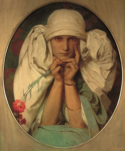 Girl in a white headdress resting her head in her hands